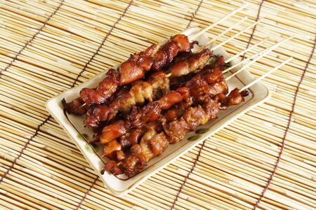 Delicious chicken satay on skewers photo