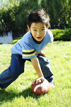 A boy having fun playing football photo