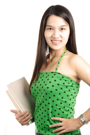 A pretty college student carrying books (isolated white) Stock Photo - 555917