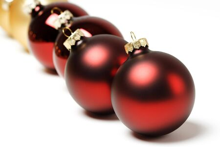 trinkets: Red and golden christmas ornaments in a row Stock Photo