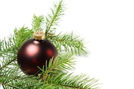 A red christmas ornament with christmas tree photo