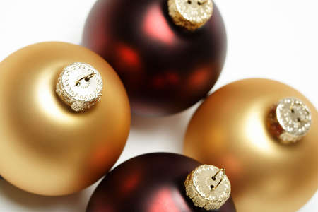 Close up of gold and red christmas tree ornaments photo