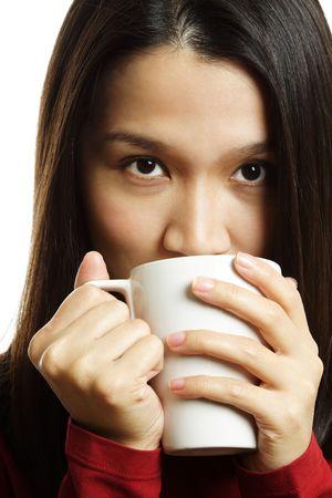 sorbo: Una hermosa mujer joven la celebraci�n de una taza de caf�