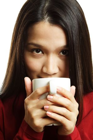 sip: A beautiful young woman drinking a hot cup of coffee Stock Photo
