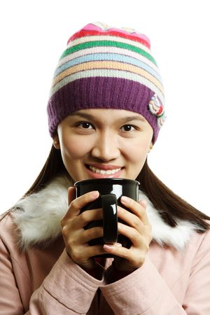 sip: A beautiful girl holding a cup of hot drink