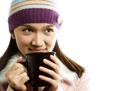 A beautiful girl wearing winter dress holding a cup of hot drink Stock Photo - 605208
