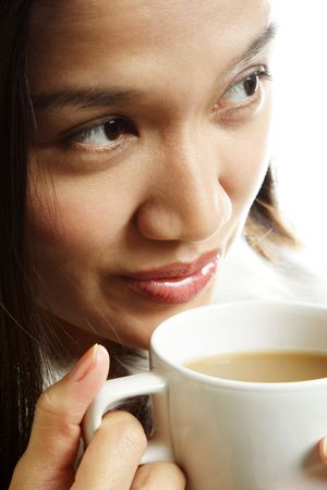 sip: A beautiful woman drinking a hot cup of coffee Stock Photo