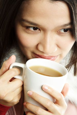 A beautiful young woman holding a cup of hot drink Stock Photo - 609228