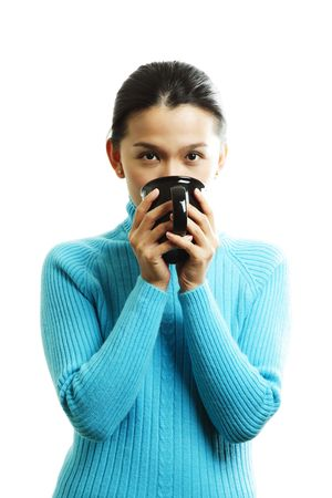 A pretty woman holding a cup of hot drink photo