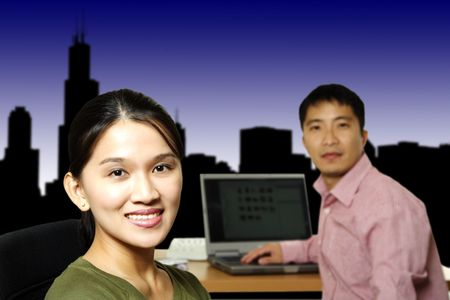 Businessman and businesswoman working together in an office photo