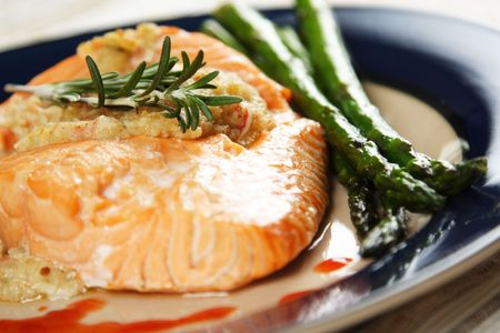 Baked stuffed salmon with asparagus on the side Stock Photo - 629428