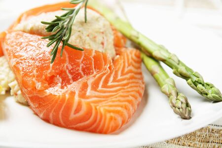 Stuffed salmon with green asparagus on the side Stock Photo - 637645