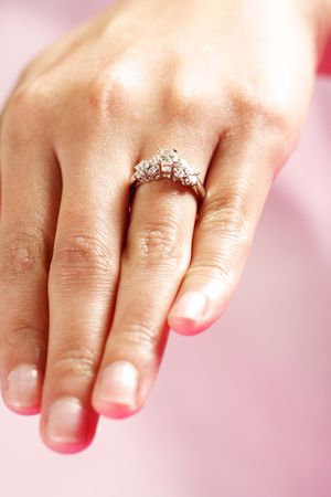 A woman hand wearing a diamond ring Stock Photo - 663915