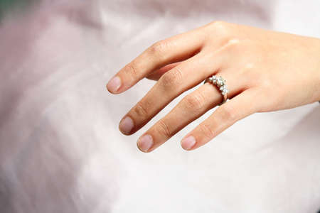 A woman hand wearing a diamond ring Stock Photo - 666077