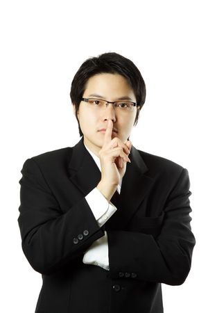 quietness: Businessman with his finger on his lips Stock Photo