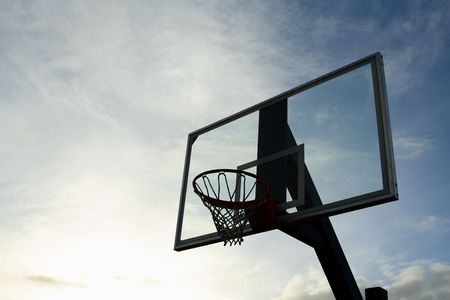 Outdoor basketball hoop on a cloudy day photo
