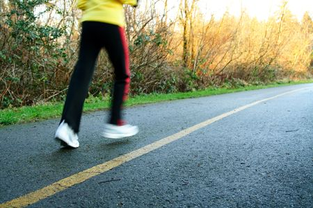 A woman exercising and running in the afternoon Stock Photo
