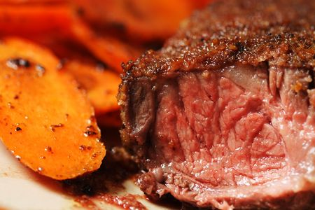 side of beef: Fried beef steak with carrots on the side