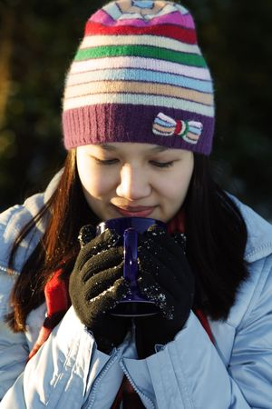 A pretty woman drinking hot drinks outdoor Stock Photo - 705461