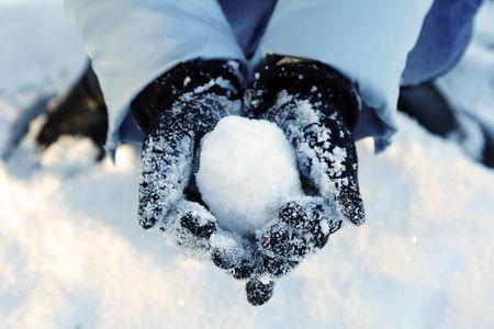A womans hand holding a snowball Reklamní fotografie