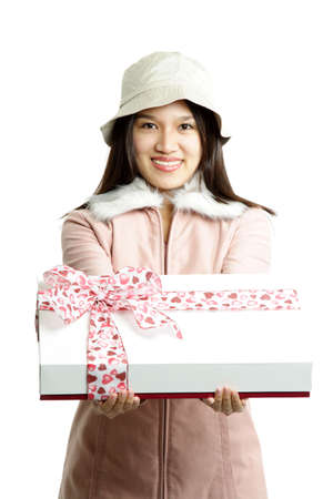 A woman carrying a gift box with pink ribbon photo