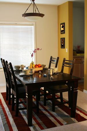 Dining table and plates on a dining table (note: pics on the wall are mine) Stock Photo - 907611