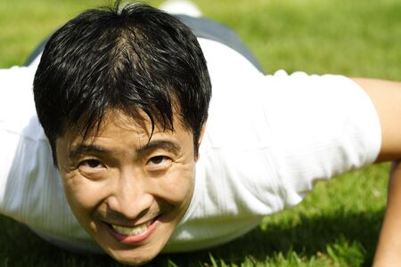 A man exercising by doing push ups  photo