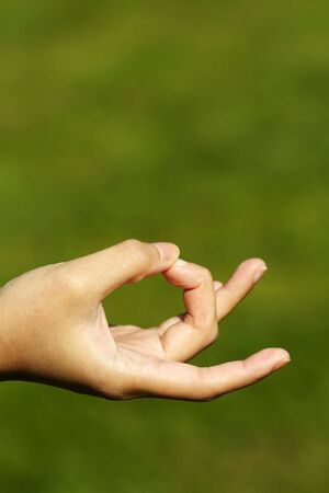 ini: A hand with fingers ini meditationyoga position Stock Photo
