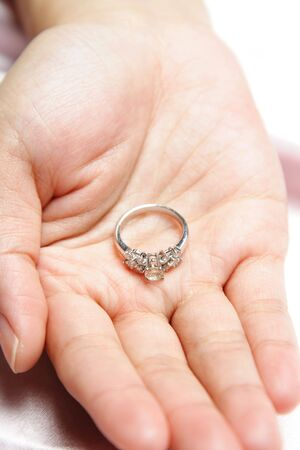 A woman with a diamond engagement ring on her hand Stock Photo