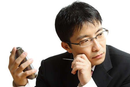 dayplanner: An isolated shot of a businessman planning with his PDA