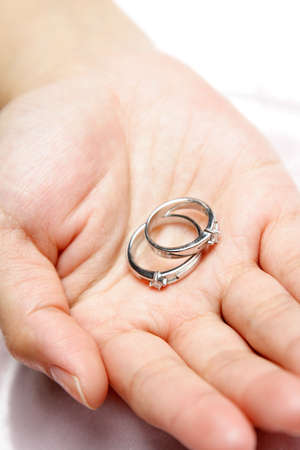 A woman holding a pair of wedding rings Stock Photo - 938915
