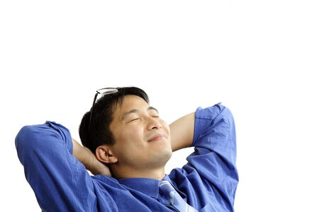 daydreaming: A businessman relaxing comfortably at his office