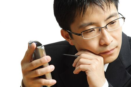 dayplanner: A shot of a businessman working on his PDA