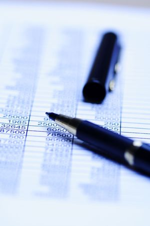 A close up shot of a spreadsheet and a pen, can be used for accounting concept ( shallow DOF) Banco de Imagens