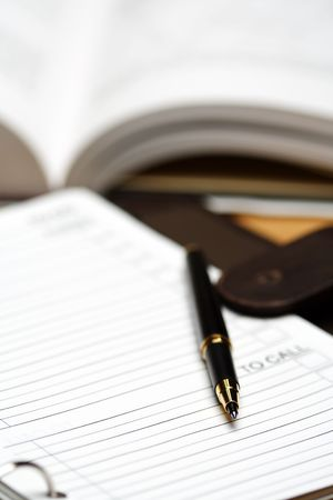 A meeting planner and a pen, showing a business meeting concept Stock Photo