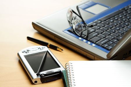 A PDA, notebook and laptop in a typical business environment setting