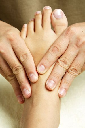A masseuse massaging the foot of a woman Stock Photo - 946004