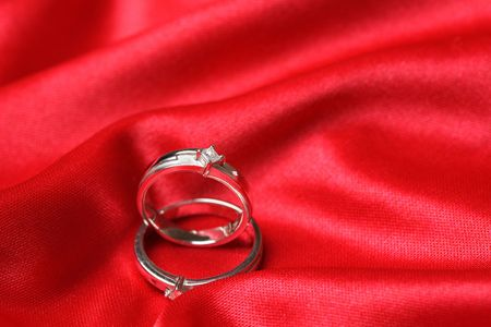 pricey: A pair of wedding rings on a red cloth