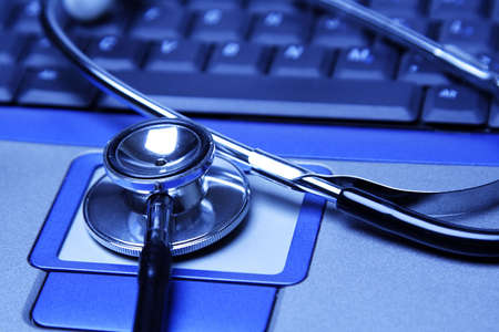 A stethoscope and a laptop in a blue tone Stock Photo - 946008