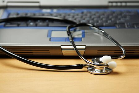A stethoscope and a laptop, can be used in healthcare concept