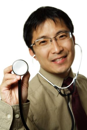 heartrate: A male doctor holding up a stethoscope, can be used in healthcare concept