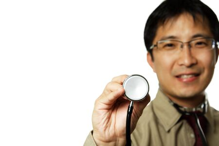 heartrate: A male doctor holding up a stethoscope, can be used as healthcare concept Stock Photo