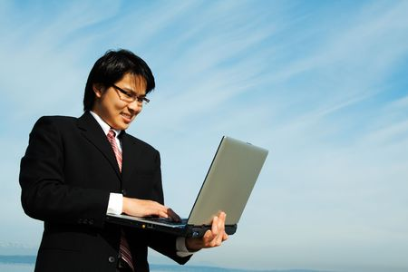 A businessman working on his laptop outdoor Stock Photo - 968469