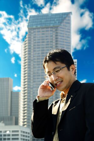 businessman talking: A businessman talking on the phone at a business district Stock Photo