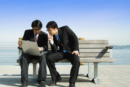 Two businessmen working together on a laptop  Stock Photo - 1236719