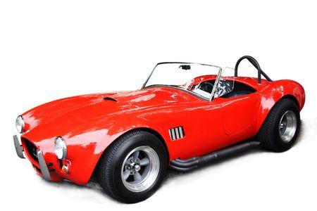 Een geïsoleerde shot van een klassieke rode sport auto Stockfoto