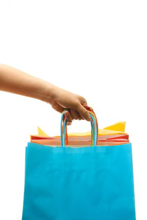 carry on bags: A woman carrying a bunch of shopping bags