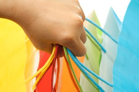 A woman carrying a bunch of colorful shopping bags Stock Photo