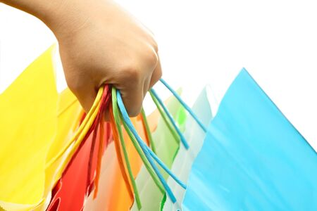 A woman hand carrying a bunch of colorful shopping bags Stock Photo - 1342913