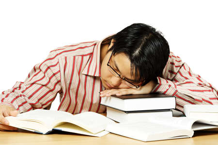 An isolated shot of a young man falling asleep while reading books Stock Photo - 1462945